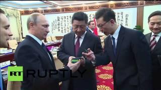 China: Putin gifts Xi Jinping world