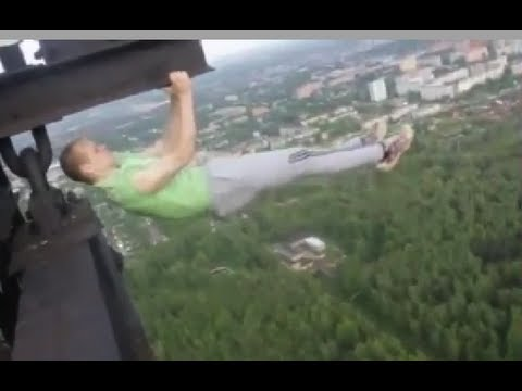 Insane Guys Hang Off Electrical Tower YouTube - Crazy guy base jumps radio tower