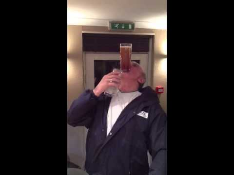 Man drinking a pint with no hands