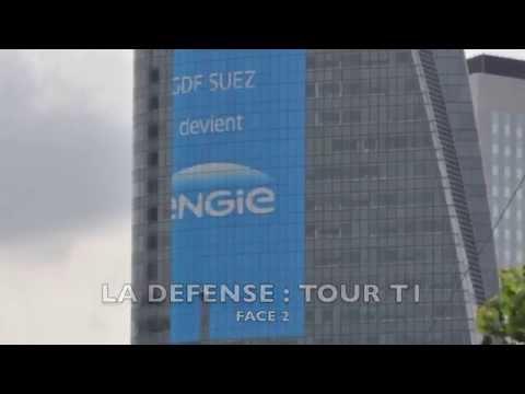 Pose d'adhésifs grands formats sur des tours vitrées à Paris - La Défense et Bruxelles par iDzif Pro