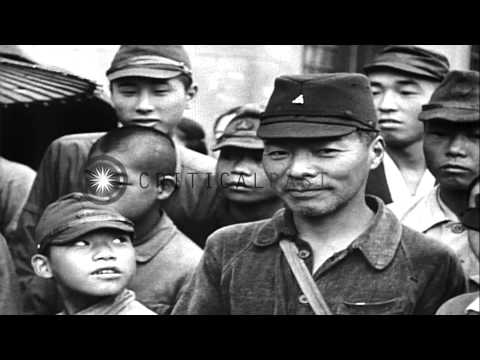 Hideki  Tojo in hospital after attempting suicide and Japanese people reads bulle...HD Stock Footage