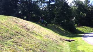 2013 John Deere X738 with front blade and 3-point hitch mowing steep hills
