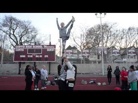 Watch the Curtis High School cheerleaders in action