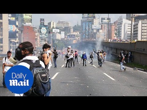 Massive protests erupt in Caracas for banned opposition leader - Daily Mail