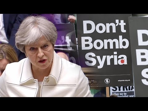 British PM insists Syria strikes legal as protests simmer