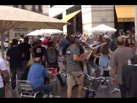 Barcelona clashes: Chairs fly as protesters face off on national day