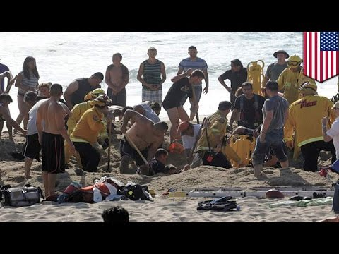 Man buried alive in sand tunnel collapse at Half Moon Bay beach, California - TomoNews US  - -d_9gWQIoeQ -