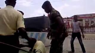Soldier beating lasma in lagos.