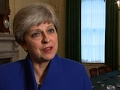 May: Conservative Govt in 'National Interest'