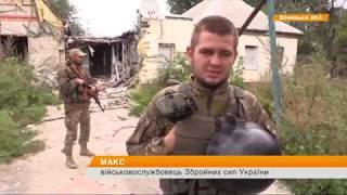 Бойцы АТО подняли украинский флаг в тылу боевиков