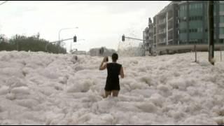 Raw: Sea Foam Blankets Australian Beach Town