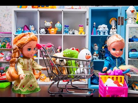 Elsa and Anna toddlers at the TOY STORE toy hunting & shopping for Chelsea's birthday present