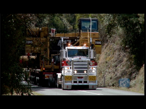 Extreme Truckers tackle Massive 1100 Horsepower V8 Mack push pull CAT 789C Dump Truck