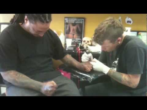 Tucker tattooing knuckles