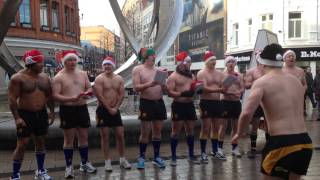 Bangor Rugby Clubs topless carol singers in Belfast for charity