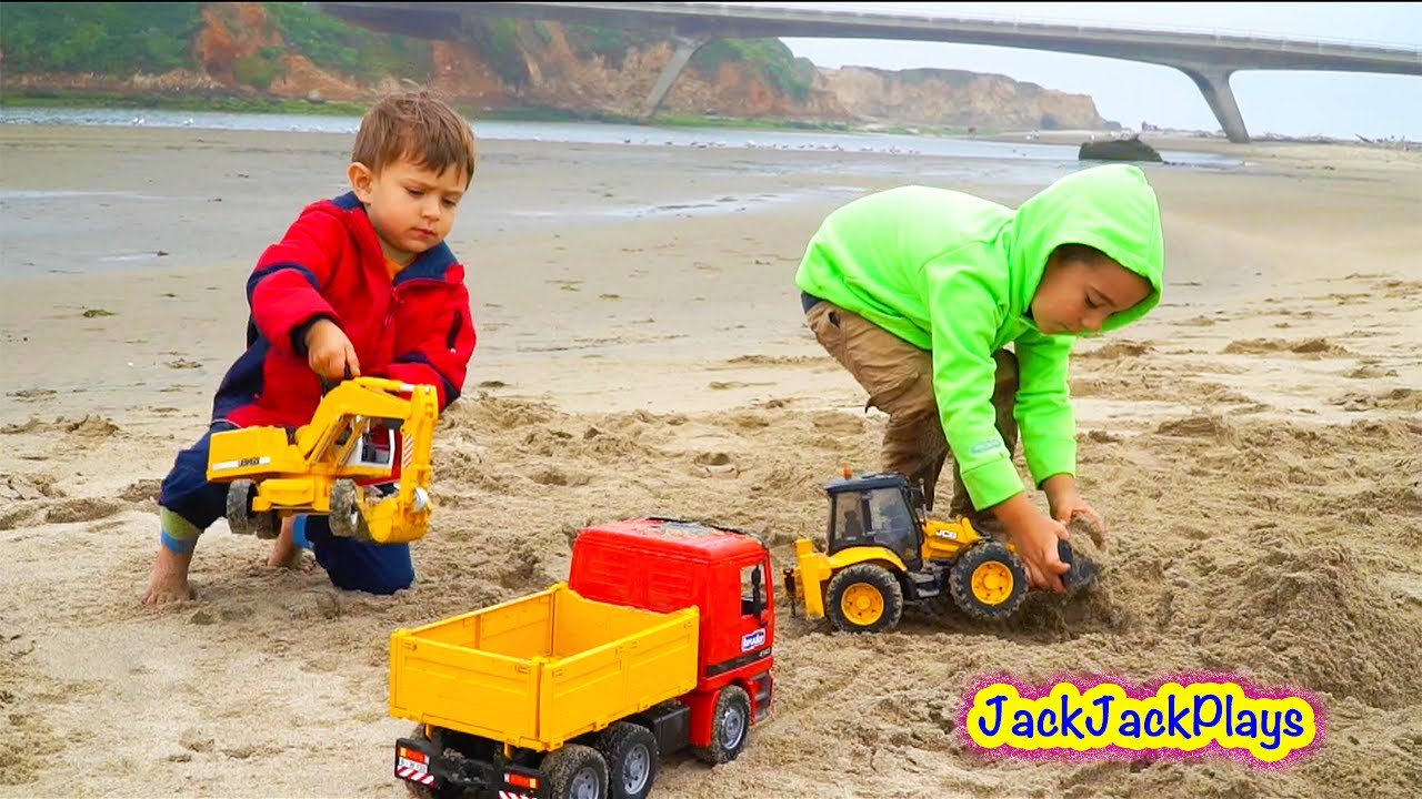 Construction Play Toys : Construction toy trucks at beach kids playing with toys
