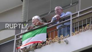 Italy Milanese sing Bella Ciao and fly flags from balconies to mark Liberation Day