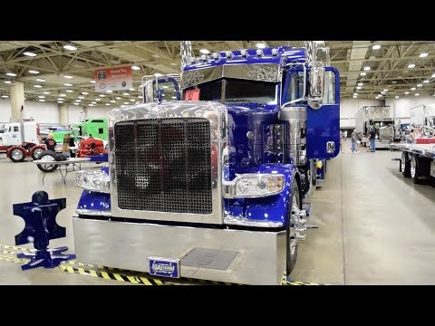 """Michael Manuel's 2015 Peterbilt 389 and Mac curtainside """"Autism: One of Many"""""""