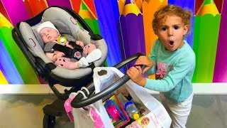 Mania doing shopping with Funny Little Baby at Toys Store
