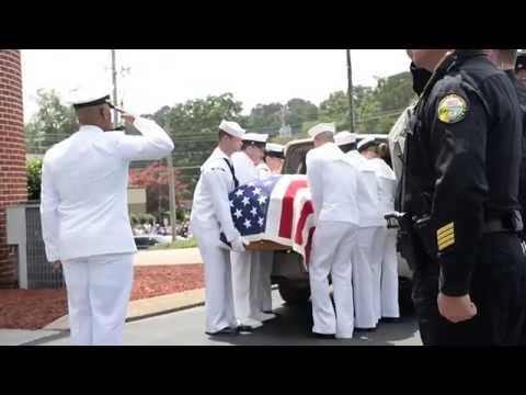 Pallbearers carry Logistics Specialist 2nd Class Randall Smith