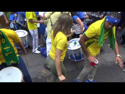 BEAUTIFUL BRAZILIAN GIRL DANCES WILD SAMBA STREET DANCE WITH A BRAZILIAN STREET SAMBA ORCHESTRA