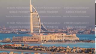Dubai skyline with villas nad Burj Al Arab during sunset timelapse