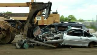 Engine Biter and Car Crusher in Junkyard