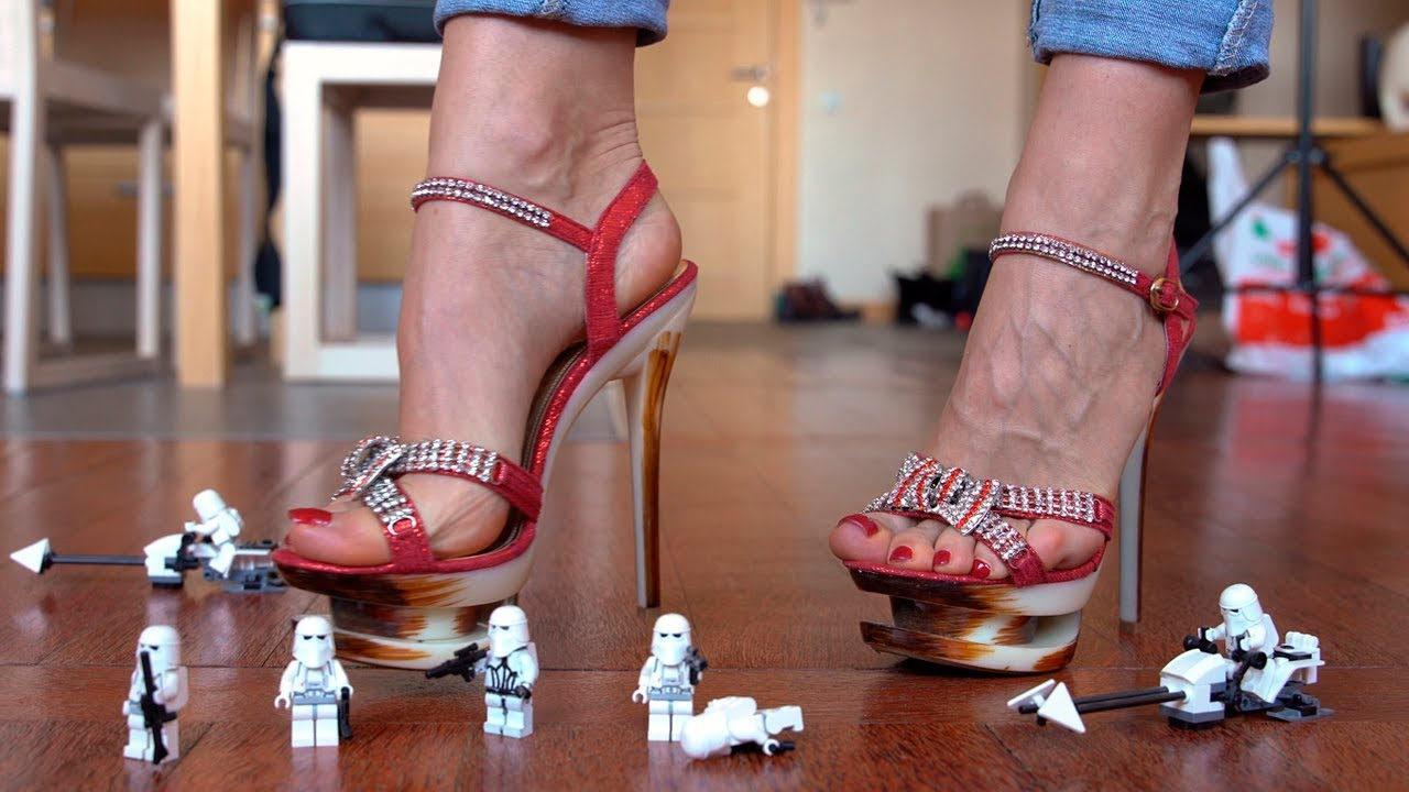Giantess with flawless feet walking on high heels