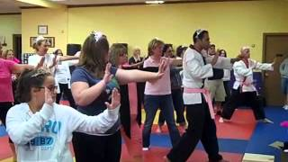 "Cancer survivors get a lesson in board breaking for the upcoming ""Flames of Hope,"" 9/20/2012"