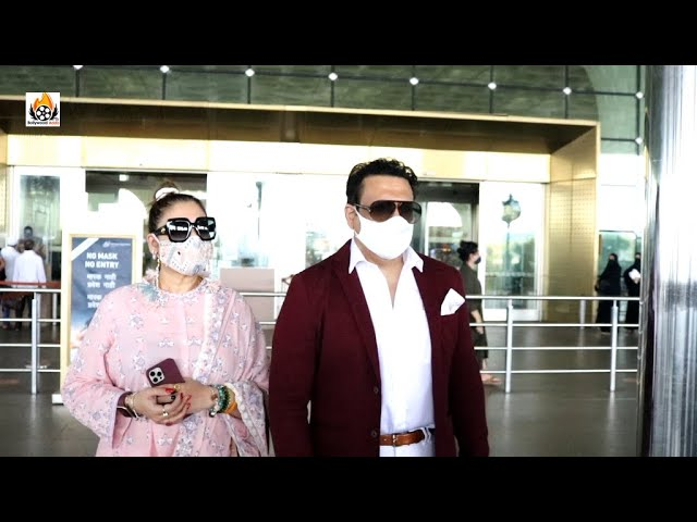 Govinda with wife Sunita Aahuja Spotted At Airport