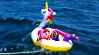 Man Tries to Catch Shark on Inflatable Unicorn