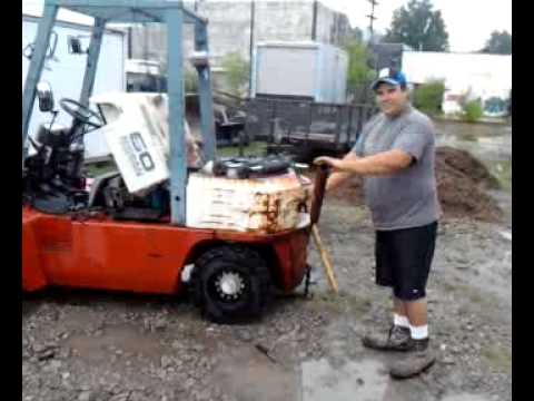 Try remove 1 Giant bolt on Counter weight on Nissan 60 Forklift