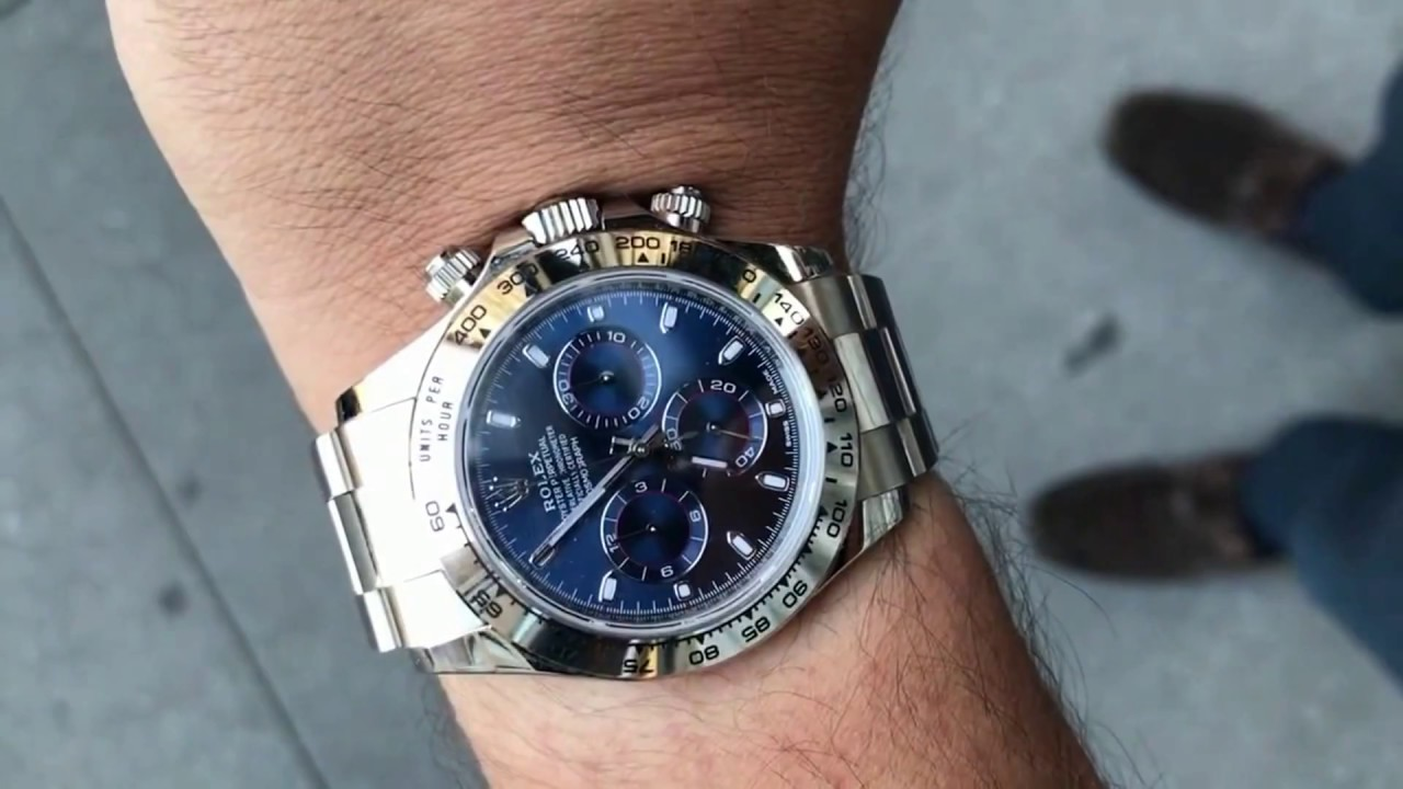 Rolex Daytona 116509 Blue Dial 40 mm white gold swiss made luxury watch  shining on wrist
