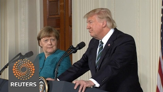 """Trump tells Merkel """"at least we have something in common"""" on wiretapping"""