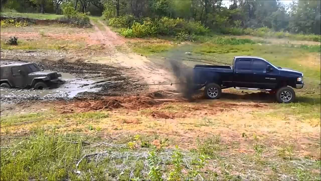 Dodge Cummins 4x4 pulling jeep out of mud - YouTube