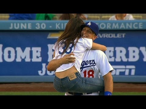 Sarah Shahi excitedly leaps into Tim Federowicz's arms after first pitch