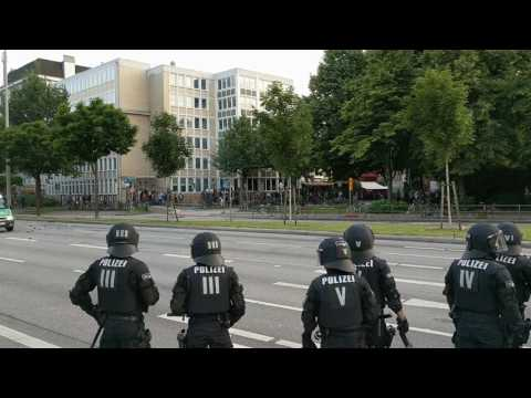 Police cars get attacked during riots in Hamburg