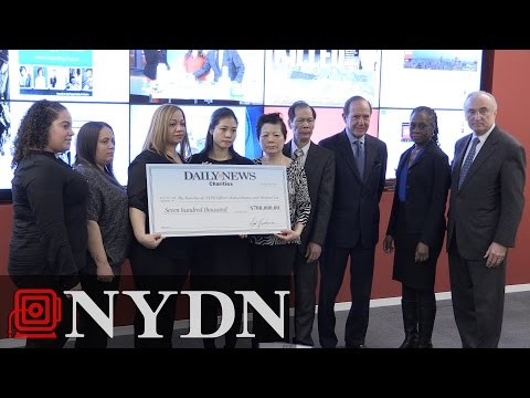 New York Daily News Presents Check to Families of Officer