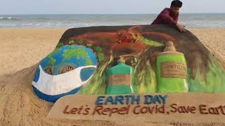Puri: Artist makes sand art on occasion of Earth Day, urges people to fight Covid