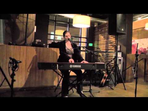 "Singing/playing my original song, ""The Other Side"", at the Teavolve Cafe/Lounge in Baltimore, MD."