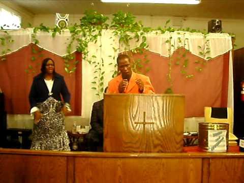Minister Elisha Cook Praying
