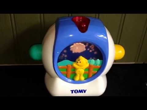 TOMY Adorable Children's Moving Musical Cot Toy Video with Projecting Lights Image & Music