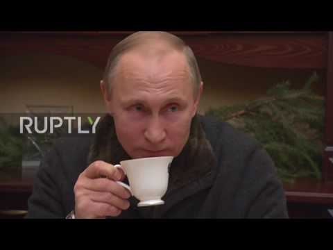 Russia: Putin meets fishermen friends on Christmas tour of St. George's Monastery