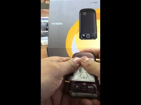 Removing back cover and installing battery in Nokia 3710 fold mobile phone
