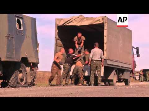 As rebels advance, Ukrainian soldiers flee through humanitarian corridor