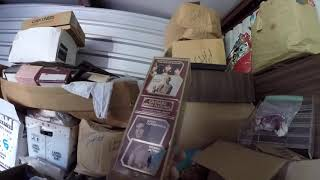 Looking For good stuff in a storage room auction Never know what You will find Trash or treasure