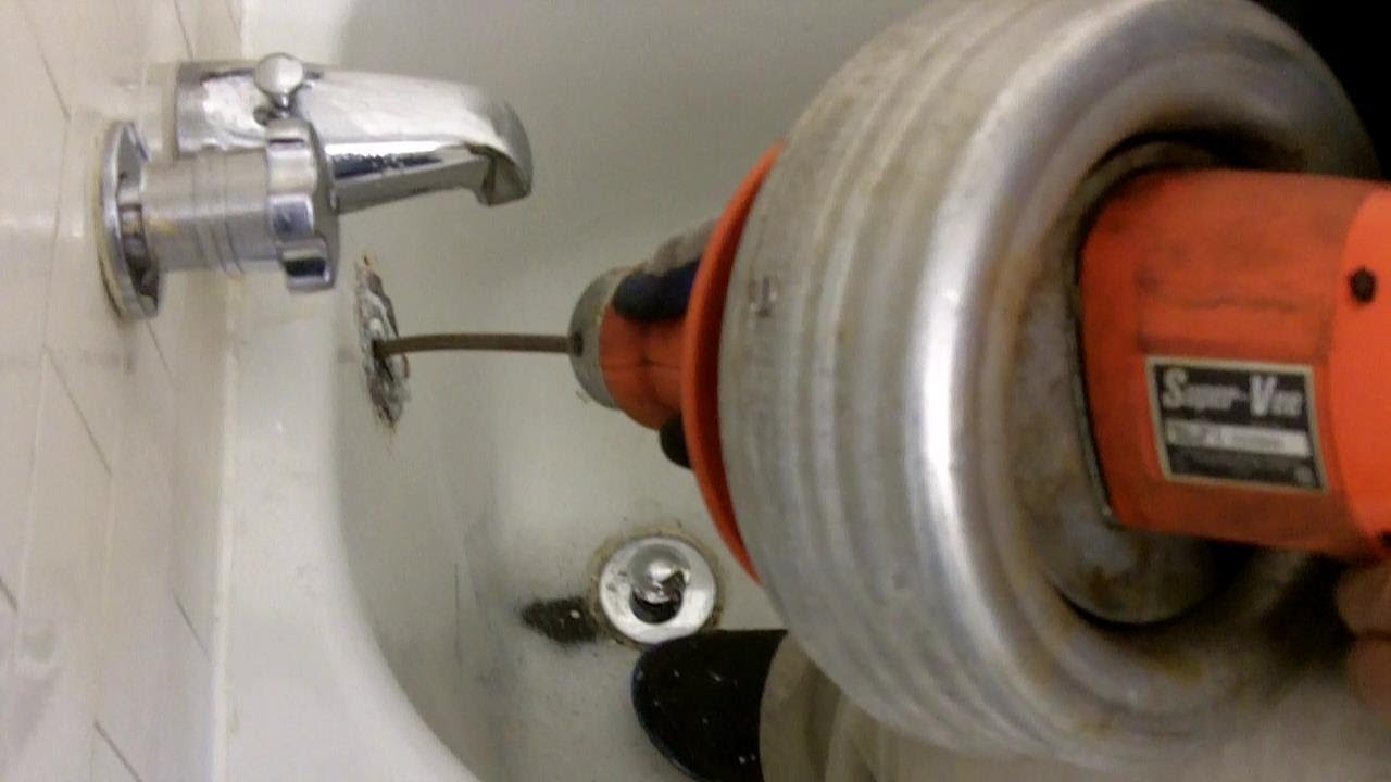 How to Snake Bathtub Drain through Overflow with Electric ...