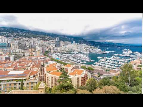 Monte Carlo city aerial panorama timelapse. View of luxury yachts and apartments in harbor of Monaco