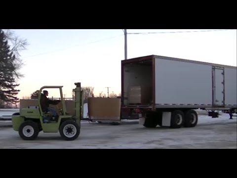 Clark IT-40 Forklift Moving Pallets of Moss
