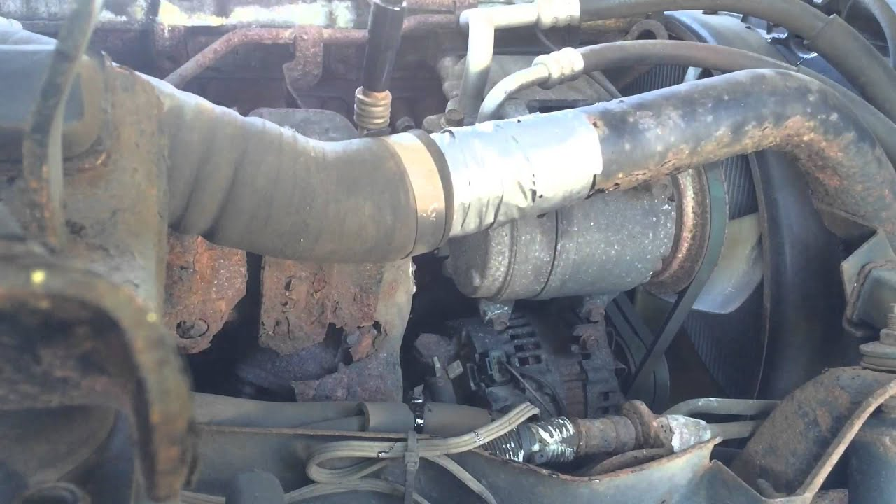Roadside repair of turbo line on a 2006 Isuzu NPR box truck